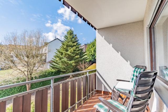 Chairs on a sunny balcony